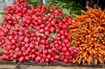 Beets and carrots at the farmers' market. Union Square, New York City, New York, USA.